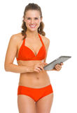 Happy young woman in swimsuit with tablet pc Royalty Free Stock Photos