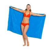 Happy young woman in swimsuit with towel Royalty Free Stock Photo