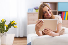 Happy young woman with tablet Royalty Free Stock Photos