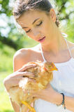 Happy young woman taking care of chicken Royalty Free Stock Photo