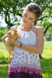Happy young woman taking care of chicken Royalty Free Stock Photography