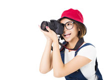 Happy young woman taking photo on camera Stock Photo