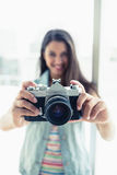 Happy young woman taking a photo at camera Royalty Free Stock Photography