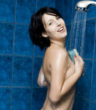 Happy young woman taking a shower Stock Photography