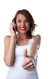Happy Young woman talk on cell phone and thumbs up Stock Image