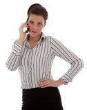Happy young woman talking on cell phone Stock Images
