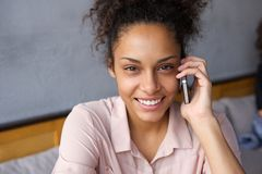 Happy young woman talking on cell phone Royalty Free Stock Photography
