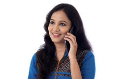 Happy young woman talking on cellphone Royalty Free Stock Images