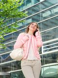 Happy young woman talking on cellphone outdoors Stock Photography