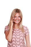 Happy young woman talking on mobile phone Stock Photography