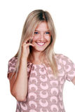 Happy young woman talking on mobile phone. Portrait of a happy young woman talking on mobile phone isolated on white background royalty free stock photos