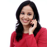 Happy young woman talking on mobile phone Royalty Free Stock Photos