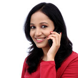 Happy young woman talking on mobile phone Stock Images