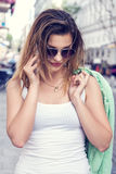 Happy young woman talking by mobile phone. Stock Images