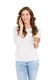 Happy young woman talking on mobile phone while having coffee. On white background Stock Photo