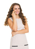 Happy young woman talking mobile phone Stock Images