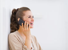 Happy young woman talking mobile phone and looking on copy space Stock Photography