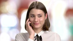 Happy young woman is talking on phone. stock footage