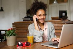 Happy young woman talking on phone at home Royalty Free Stock Photography