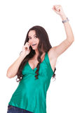 Happy young woman talking to a cell phone Royalty Free Stock Photo