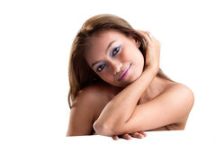 Happy young woman with tanned skin Stock Image