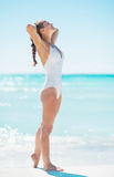 Happy young woman tanning on beach Royalty Free Stock Image