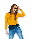 Happy young woman or teen girl in casual clothes Stock Images
