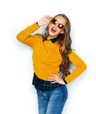 Happy young woman or teen girl in casual clothes Stock Photo
