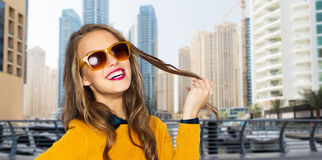 Happy young woman or teen girl in casual clothes Royalty Free Stock Photos