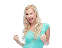 Happy young woman or teen girl celebrating victory Stock Photo