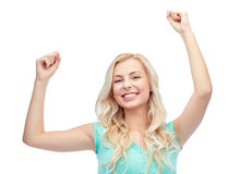 Happy young woman or teen girl celebrating victory Stock Image
