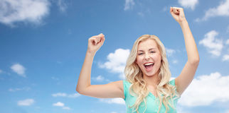 Happy young woman or teen girl celebrating victory Royalty Free Stock Photography