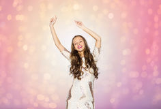 Happy young woman or teen girl dancing at party Royalty Free Stock Photography