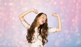 Happy young woman or teen girl dancing at party Royalty Free Stock Image