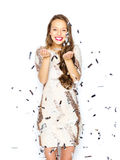 Happy young woman or teen girl in fancy dress Stock Photos