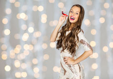 Happy young woman or teen girl in fancy dress. People, style, holidays, celebration and fashion concept - happy young woman or teen girl in fancy dress with Royalty Free Stock Photo