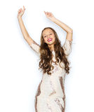 Happy young woman or teen girl in fancy dress. People, style, holidays and fashion concept - happy young woman or teen girl in fancy dress with sequins and long Royalty Free Stock Photo