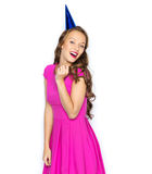 Happy young woman or teen girl in party cap Stock Image