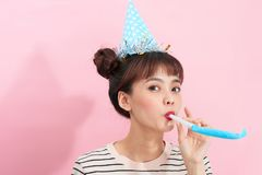 Happy young woman or teen girl with party horn.  Royalty Free Stock Image