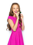 Happy young woman or teen girl with party horn Royalty Free Stock Photography
