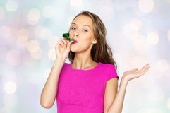 Happy young woman or teen girl with party horn Stock Image