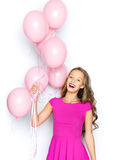 Happy young woman or teen girl in pink dress Stock Images