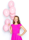 Happy young woman or teen girl in pink dress Stock Image