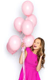 Happy young woman or teen girl in pink dress Royalty Free Stock Photos