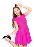 Happy young woman or teen girl in pink dress. People, holidays and fashion concept - happy young woman or teen girl in pink dress and princess crown Royalty Free Stock Photos