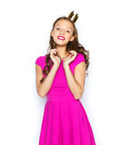 Happy young woman or teen girl in pink dress. People, holidays and fashion concept - happy young woman or teen girl in pink dress and princess crown Royalty Free Stock Image