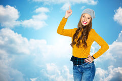 Happy young woman or teen girl pointing finger up Royalty Free Stock Image
