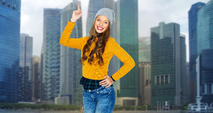 Happy young woman or teen girl pointing finger up Royalty Free Stock Photography