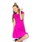 Happy young woman or teen girl in princess crown Stock Image