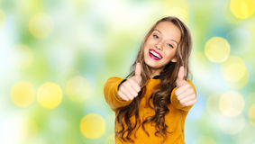 Happy young woman or teen girl showing thumbs up Stock Image